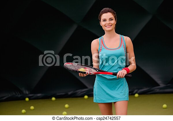 Cheerful woman with racquet and tennis ball - csp24742557