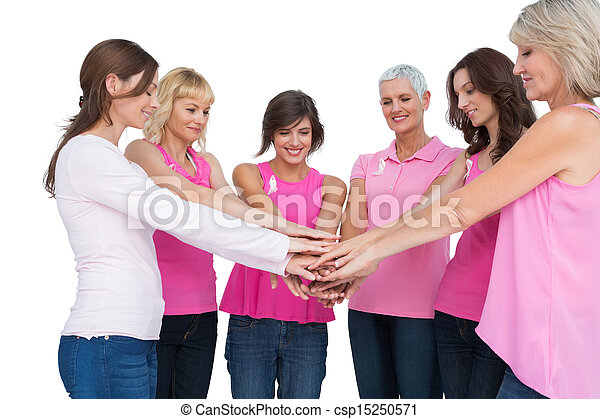 Cheerful women posing in circle wearing pink for breast cancer - csp15250571