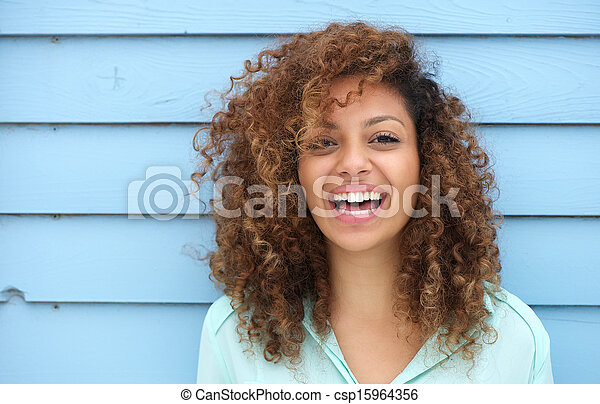Cheerful young african woman smiling - csp15964356