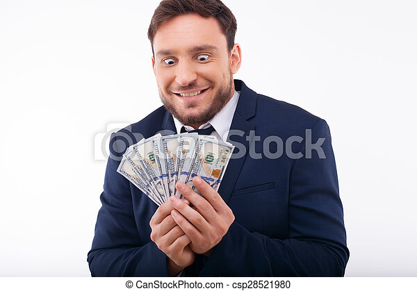 Cheerful young guy is crazy about dollars - csp28521980