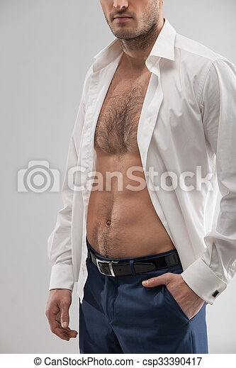 b49827850 Cheerful young man with a perfect body. Attractive sexy guy is ...