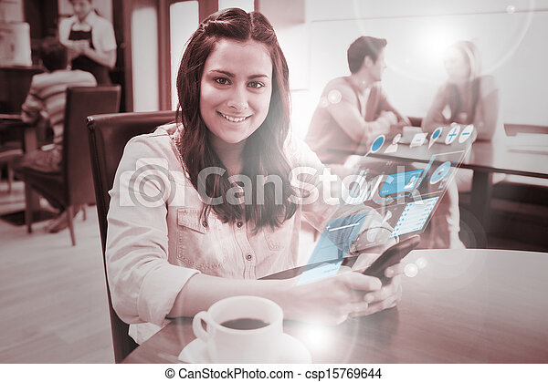 Cheerful young woman studying on f - csp15769644
