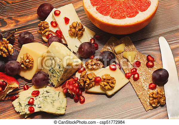 Cheese plate close-up capture - csp51772984 & Cheese plate close-up capture. Plenty varieties of aged cheese with ...