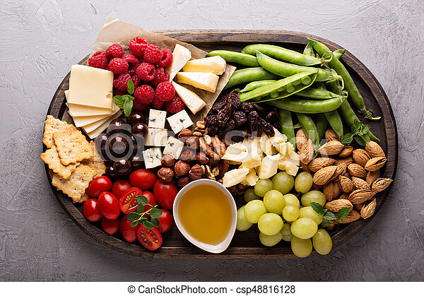 Cheese plate with fresh vegetables and fruits - csp48816128 & Cheese plate with fresh vegetables and fruits. Cheese plate with nut ...