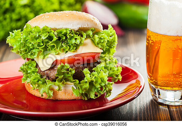 Cheeseburger on a plate with beer - csp39016056