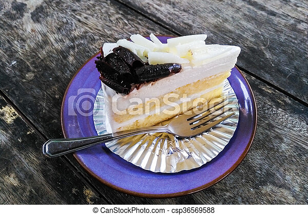 Cheesecake on a plate with spoon - csp36569588