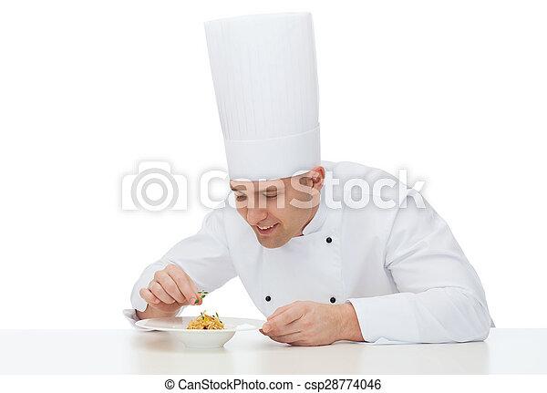 Feliz chef cocinero masculino plato de decoración - csp28774046
