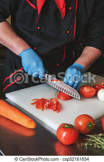 Chef cutting vegetables - csp52161634