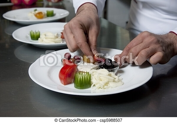Chef decorating appetizer - csp5988507