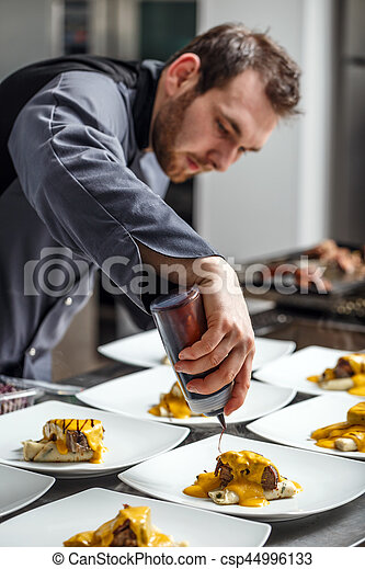 Chef finishing his plate - csp44996133