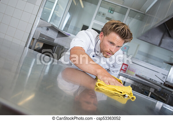 Chef polishing stainless steel work surface - csp53363052