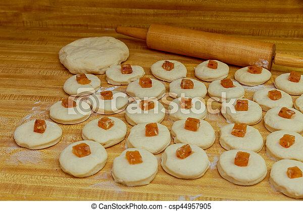 Chef preparing dough - cooking donuts process - csp44957905