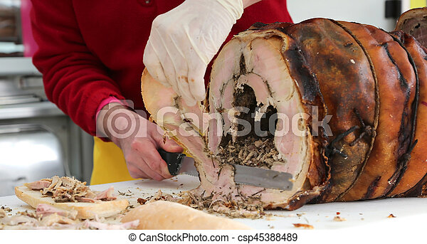 chef slicing the meat of pork to prepare a sandwich in the food - csp45388489