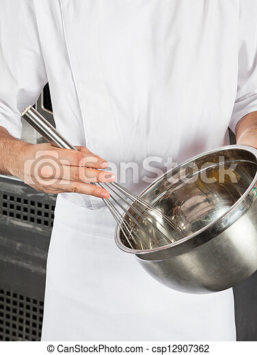 Chef With Wire Wisk And Mixing Bowl - csp12907362