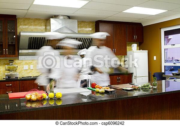 chefs cooking in kitchen - csp6096242