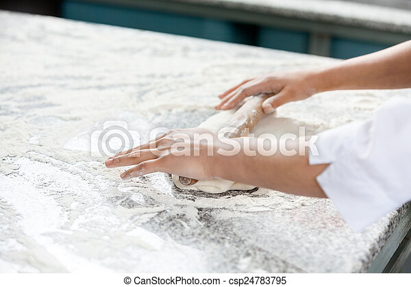 Chef's Hands Rolling Dough At Messy Counter - csp24783795