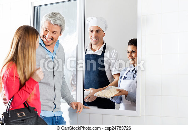 Chefs Selling Uncooked Pasta Packet To Couple - csp24783726