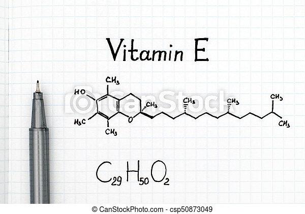 Chemical formula of Vitamin E with black pen - csp50873049