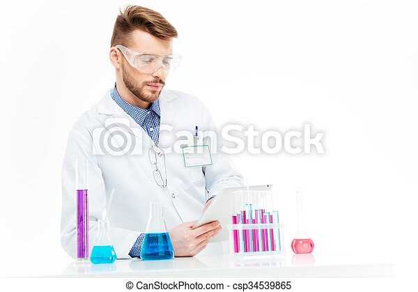 Chemist using tablet computer - csp34539865