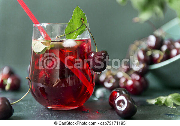 cherries , 1 Cup with lemonade , green and red shades - csp73171195