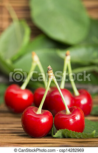 Cherries and branch with leaves - csp14282969