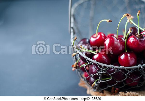 Cherries on black table - csp42138620