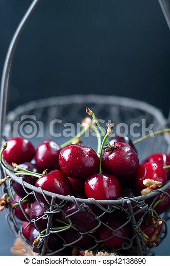 Cherries on black table - csp42138690