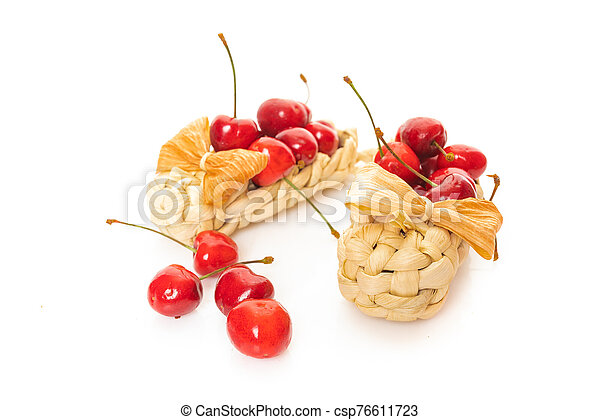 Cherry in basket isolated on a white background - csp76611723