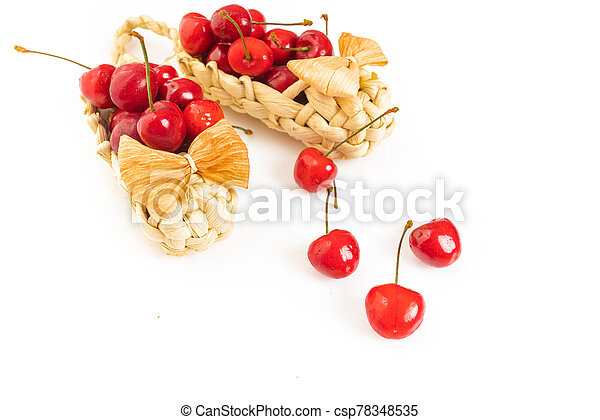 Cherry in basket isolated on a white background - csp78348535