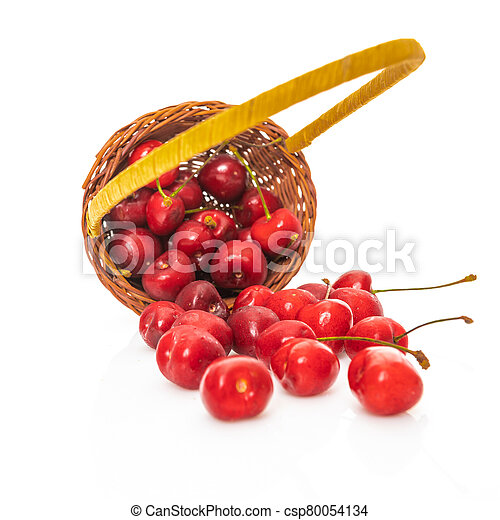 Cherry in basket isolated on a white background - csp80054134