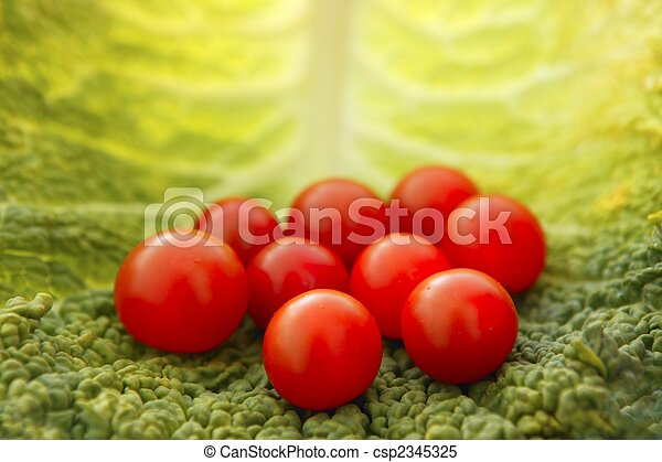 cherry tomatoes and cabbage leaf - csp2345325