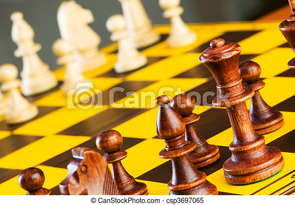 Chess concept with pieces on the board - csp3697065