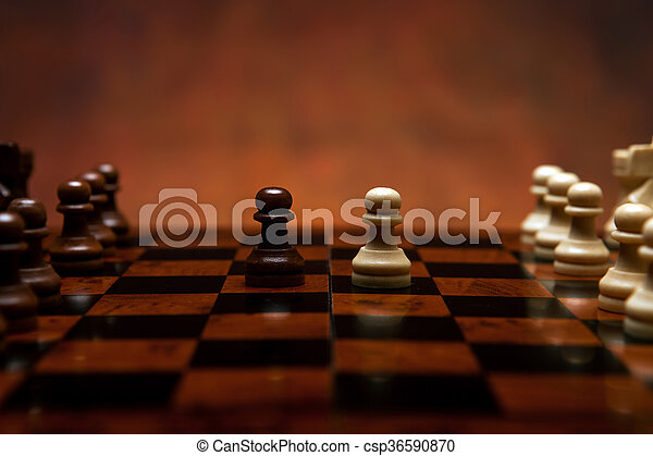 chess game with pieces on the table - csp36590870