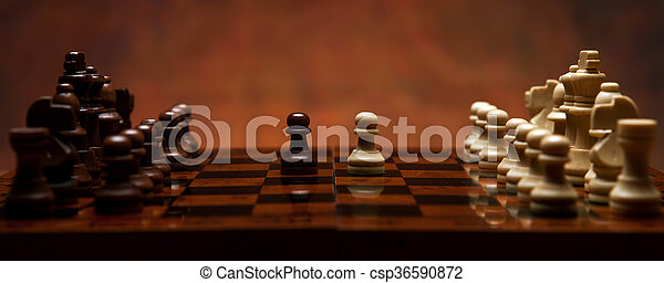 chess game with pieces on the table - csp36590872
