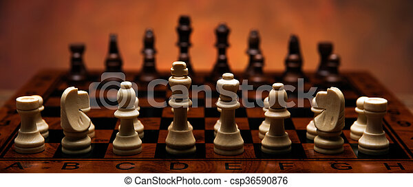 chess game with pieces on the table - csp36590876