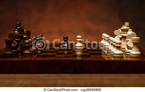 chess game with pieces on the table - csp36590868