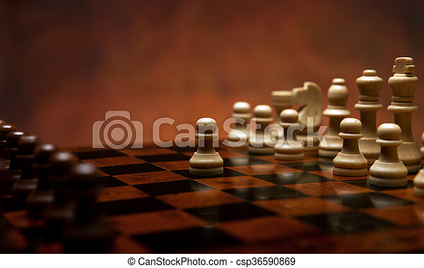 chess game with pieces on the table - csp36590869