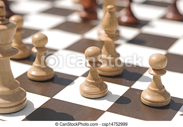 chess pieces on a table in the park - csp14752999