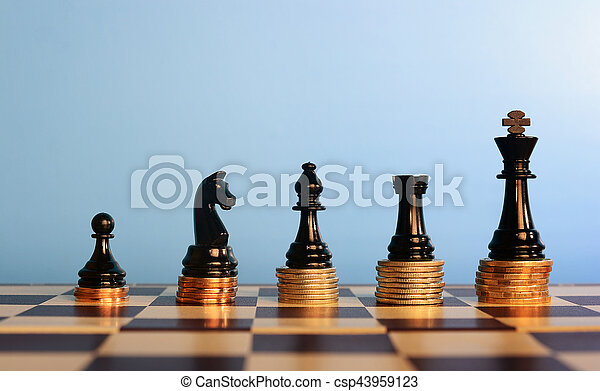 Chess Pieces On Stacked Coins Chess Pieces On Stacked Coins Against