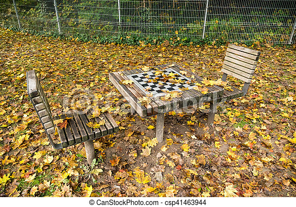 Chess Table With Two Chairs In Autumn Park   Csp41463944