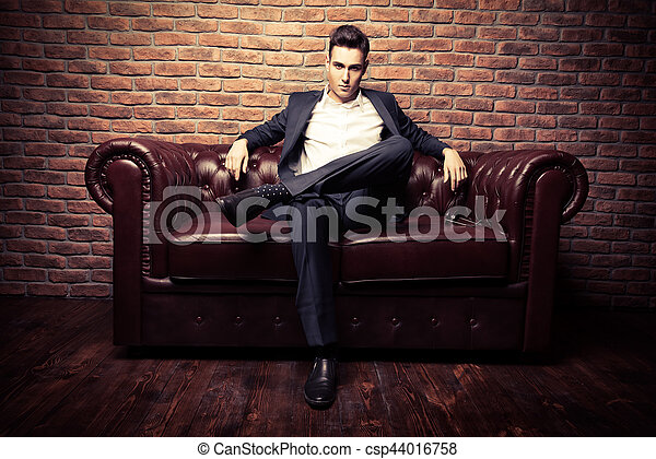 Chesterfield Sofa Imposing Well Dressed Man In A