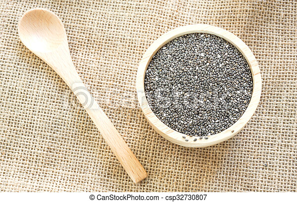 Chia seed on wooden bowl. - csp32730807
