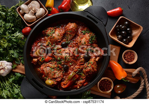 Chicken cacciatore with bell peppers, tomatoes, black olives. Italian food - csp87531174