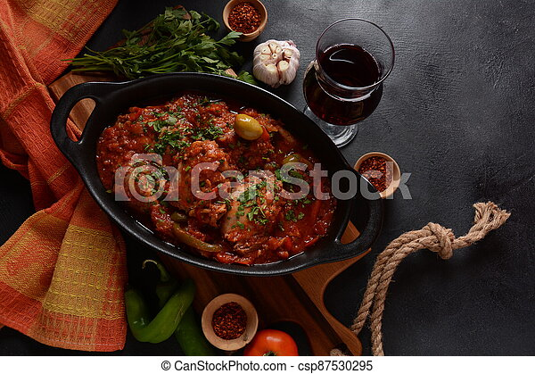 Chicken cacciatore with bell peppers, tomatoes, black olives. Italian food - csp87530295