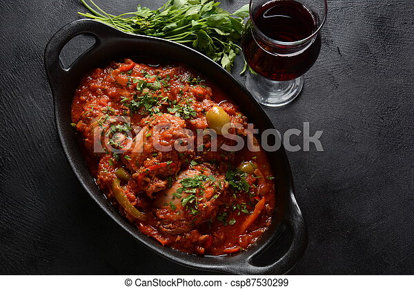 Chicken cacciatore with bell peppers, tomatoes, black olives. Italian food - csp87530299