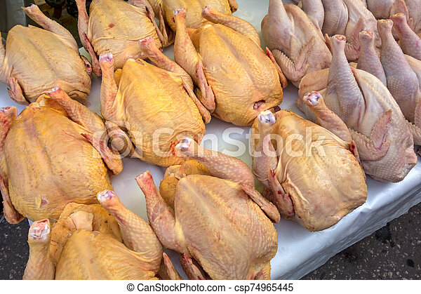 Chicken carcasses on the counter - csp74965445