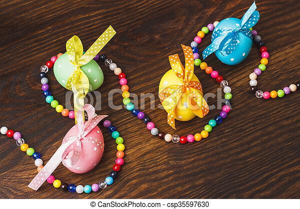 Chicken eggs with beads decorations - csp35597630