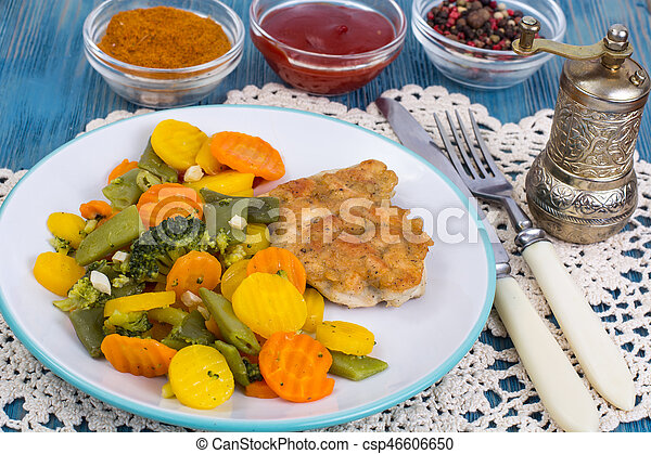 Chicken fillet grilled with vegetable mixt on wooden background - csp46606650