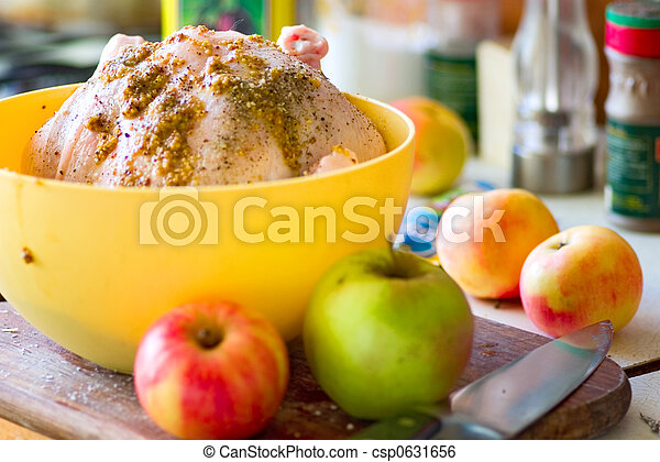 Chicken marinade and apples on the kitchen - csp0631656
