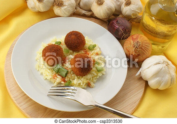 chicken meat balls with organic rice on a plate - csp3313530